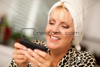 Attractive Woman Texting With Her Cell Phone with Narrow Depth of Field.