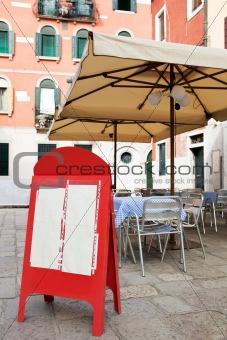 Blank menu board at small street cafe