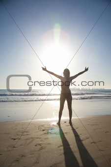 beach woman greeting sun