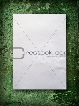 Blank paper on old green wall