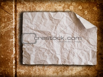 Crumpled paper on old wall