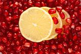 Lemon slices in pomegranate seeds