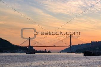 city at evening with bridge
