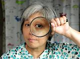 woman holding magnifier