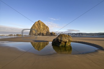 Reflection of Haystack Rock at Cannon Beach