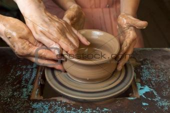 Potter teaches cooking pots
