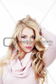 beautiful young blond woman standing, looking - isolated on white