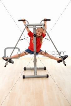 Little girl in the gym having fun
