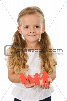Little girl holding paper people family