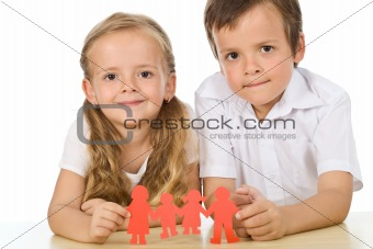 Kids holding paper people