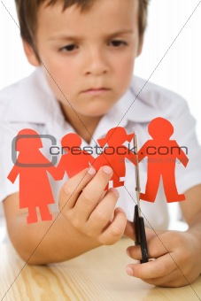 Sad kid cutting his paper people family
