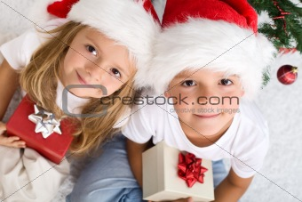 Kids with their christmas presents presents