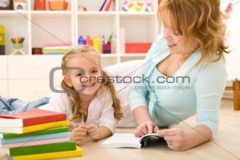 Woman reading to her little girl