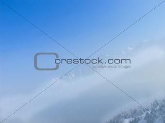 French alps seen rising above the mountain mist