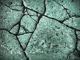 green broke rock wall