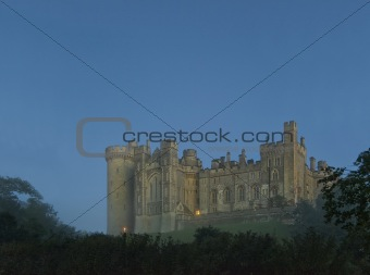 Castle before sunrise with fog and mist