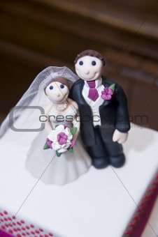 Bride and groom wedding cake ornaments detail