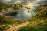 Beautiful Jurassic Coast landscape seascape with vibrant colors at sunrise sunset