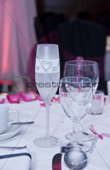 Detail of wedding champagne glass with bride written on it