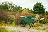 Garedning scene with wheelbarrow in country garden
