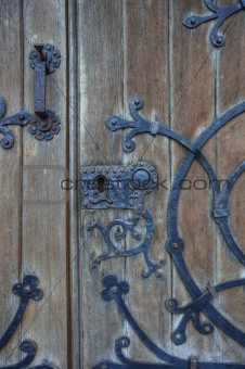 Old wooden door background with  metal lock and decoration