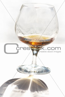 A crystal glass of cognac