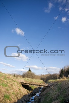 Small wooden bridge over a gully