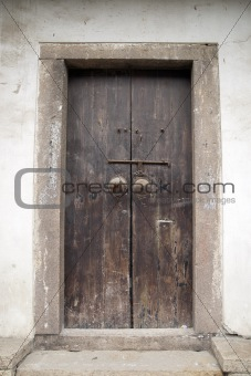 Ancient brown wooden door