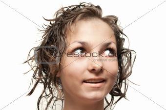 Beautiful girl with wet hair looks upwards