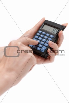 Calculator in feminine hand