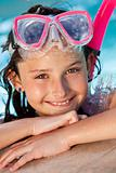 Happy Girl Child In Swimming Pool with Goggles and Snorkel