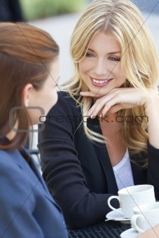 Two Beautiful Young Women Having Coffee