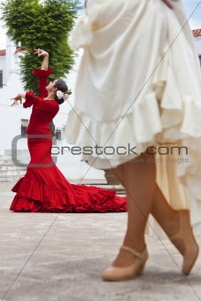 Two Traditional Women Spanish Flamenco Dancers In Town Square