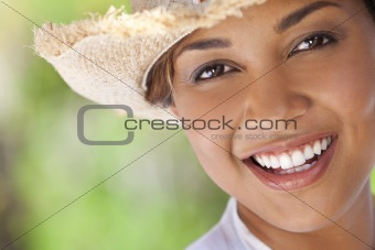 Beautiful Ethnic Mixed Race Woman Laughing In Straw Cowboy Hat