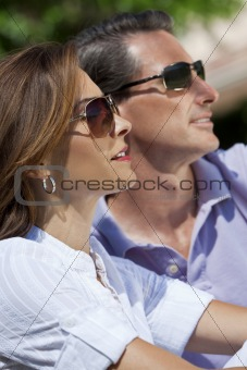 Attractive Thirties Couple In Sunshine Wearing Sunglasses