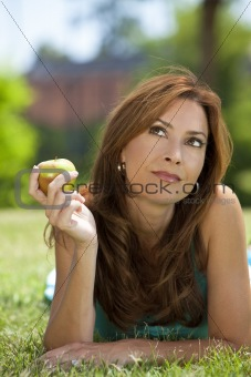 Beautiful Woman Outside Eating An Apple and Thinking