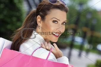 Beautiful Happy Woman With Pink and White Shopping Bags