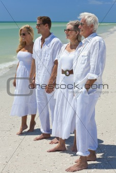 Two Couples Generations of Family Holding Hands on Tropical Beac