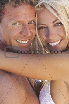 Sexy Attractive Man and Woman Couple Happy At the Beach