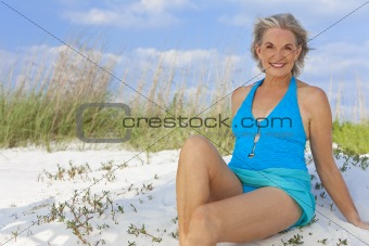 Attractive Elegant Senior Woman Sitting In Swimming Costume At B