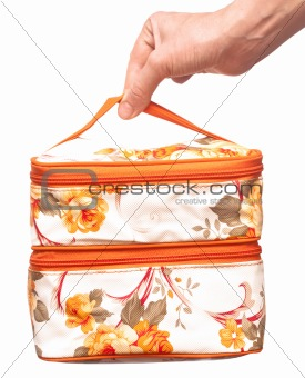 cosmetic bag in hand