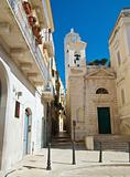 Alley with St. Salvatore Church. Trani. Apulia.