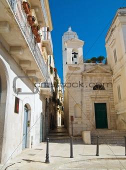 Alley with St. Salvatore Church. Trani. Apulia.