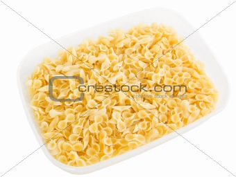 One side curled short-cut pasta in plastic container.