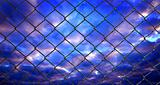 iron wire fence on blue sky  background