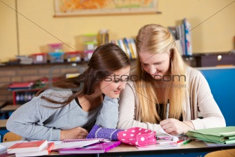 Two schoolgirls in class
