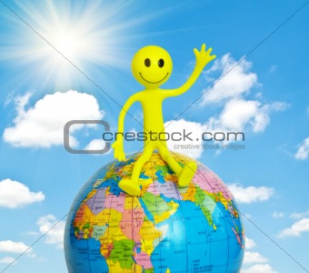 On top of the world - smilie sitting on the globe
