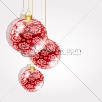 Christmas balls on golden strings on a light background