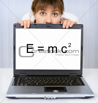 Woman shows computer screen with formula