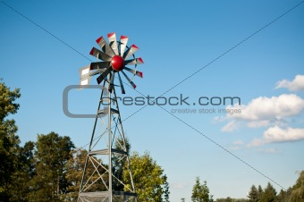 Small Windmill with Blue Sky and Clouds